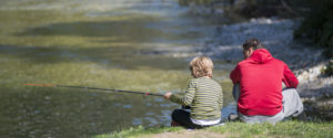 Man fishing with son